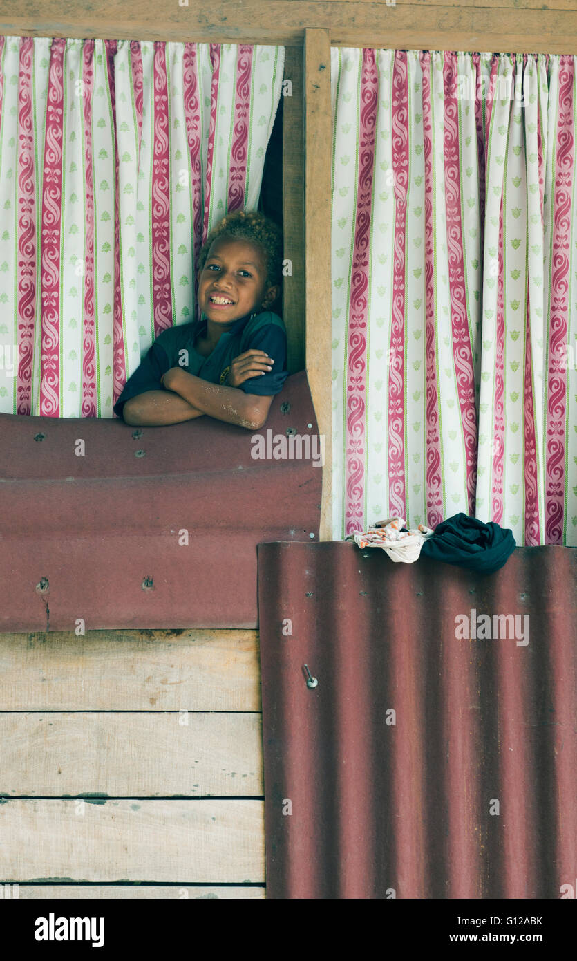 Boy in window of simple house, Owa Raha (Santa Ana) Solomon Islands, Melanesia - Stock Image
