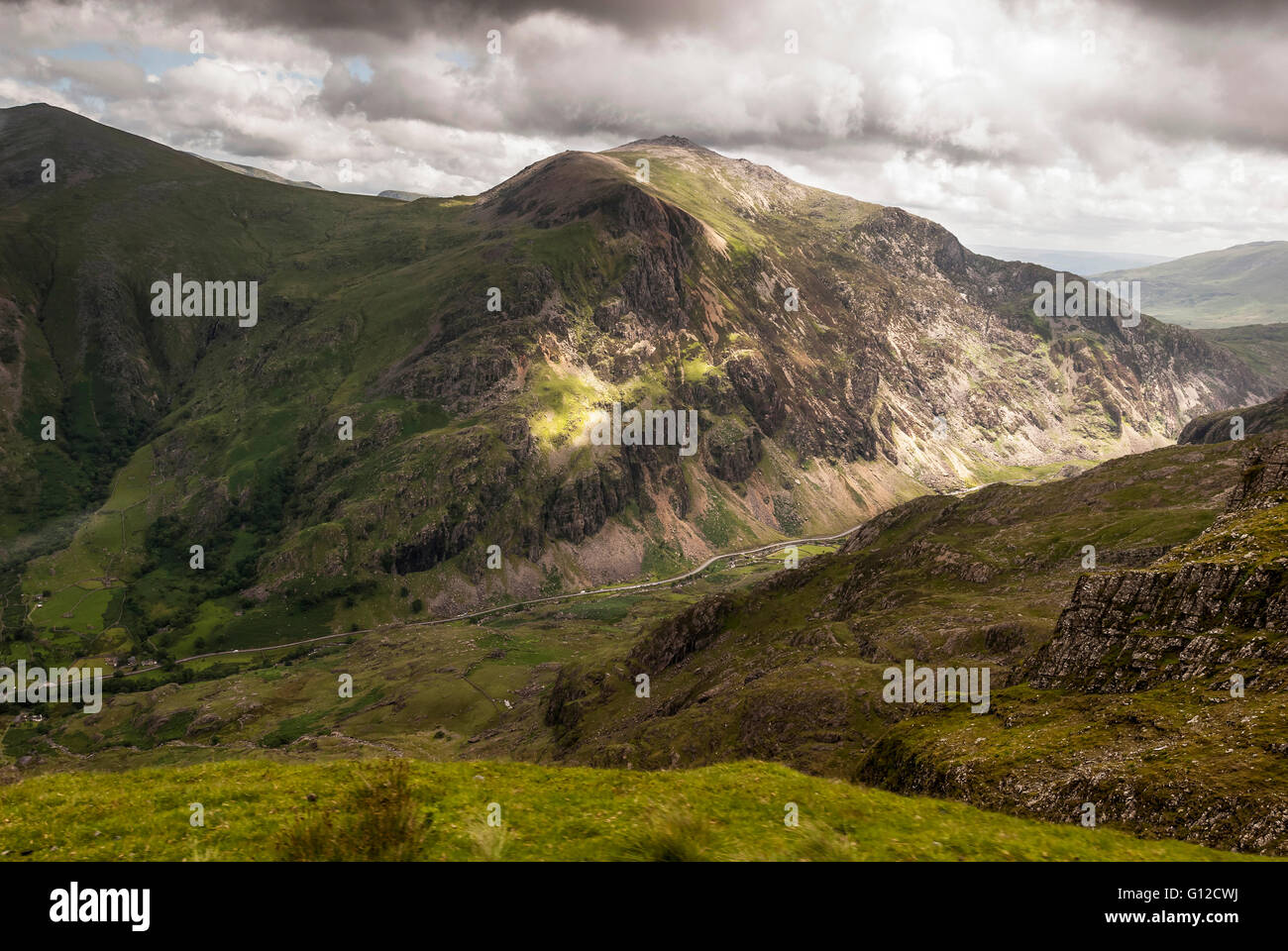 The Llanberis pass road visible from mount Snowdon. Snowdonia North Wales. - Stock Image