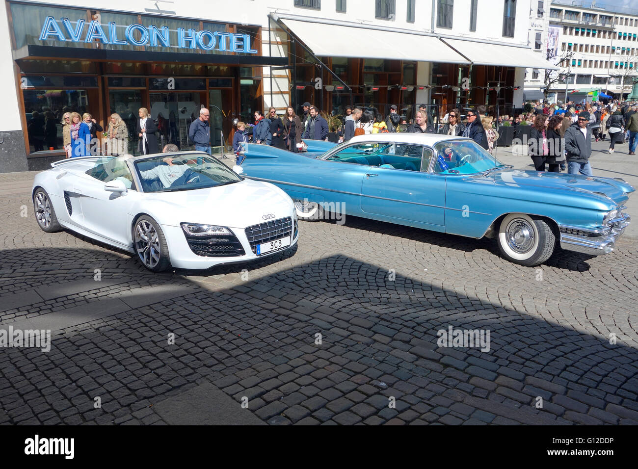 Brand new AUDI R8 from 2016 and CADILLAC DE VILLE from 1959 with Swedish licence plate - Stock Image
