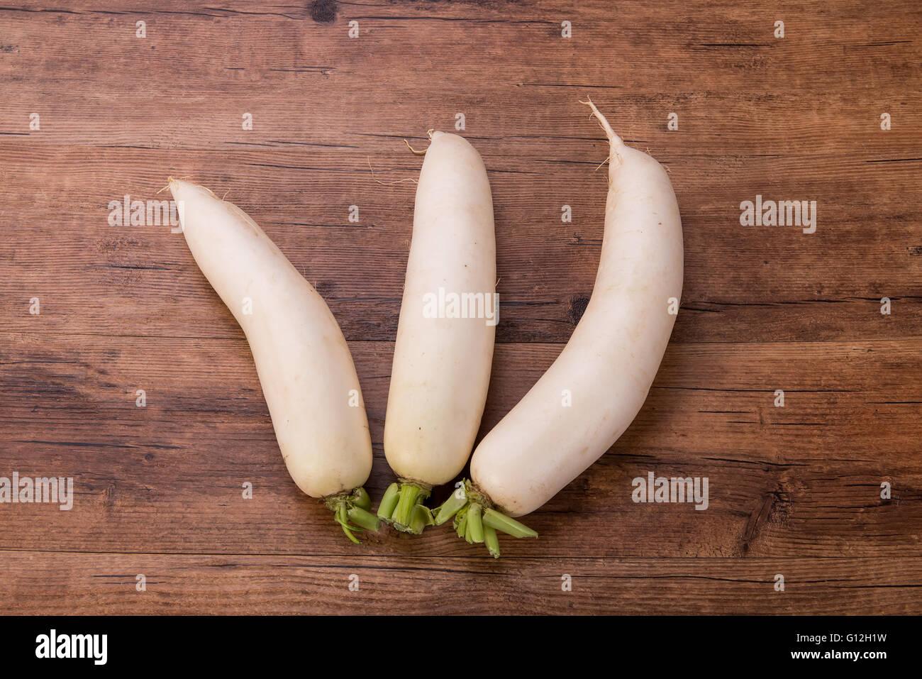 Daikon radish on the wood background Stock Photo