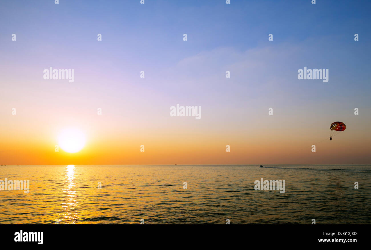 South East Asia, Vietnam, Phu Quoc island, Vinpearl Resort, paraponting at sunset Stock Photo