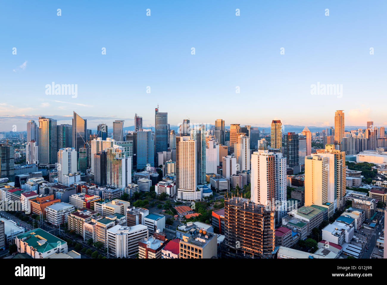 Eleveted, night view of Makati, the business district of Metro Manila. - Stock Image