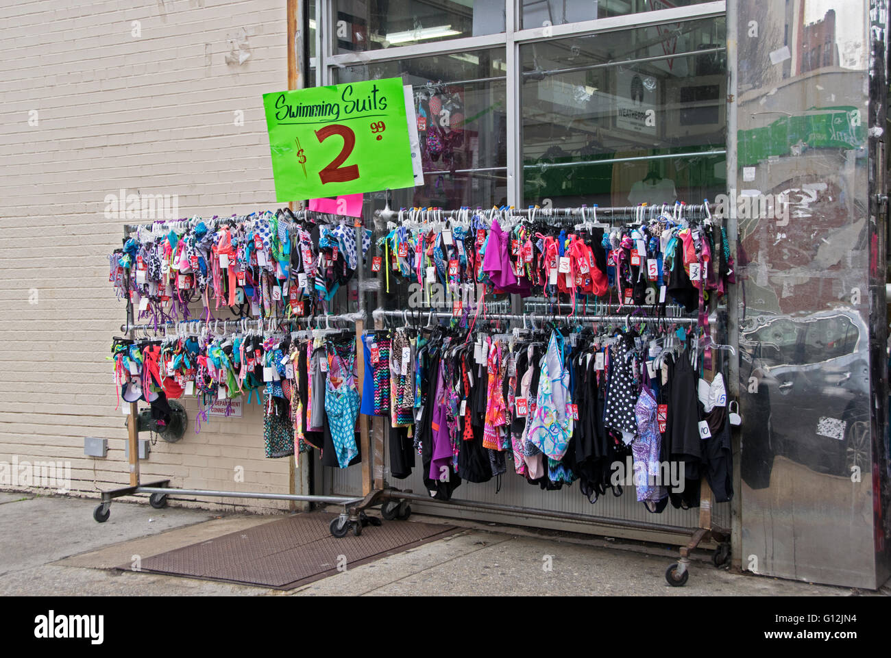 5/2016. Extremely inexpensive swim suits for sale on Brighton Beach Avenue in South Brooklyn, New York City - Stock Image
