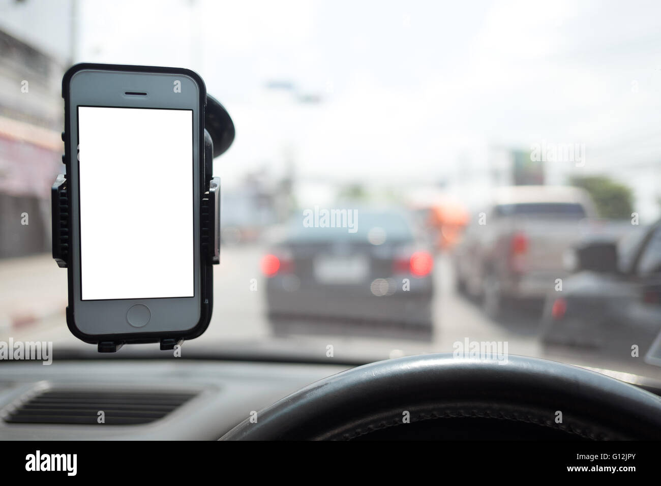 smartphone in a car  use for Navigate - Stock Image