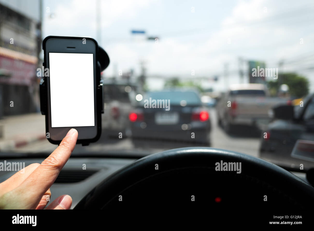 hand and smartphone in a car  use for Navigate - Stock Image