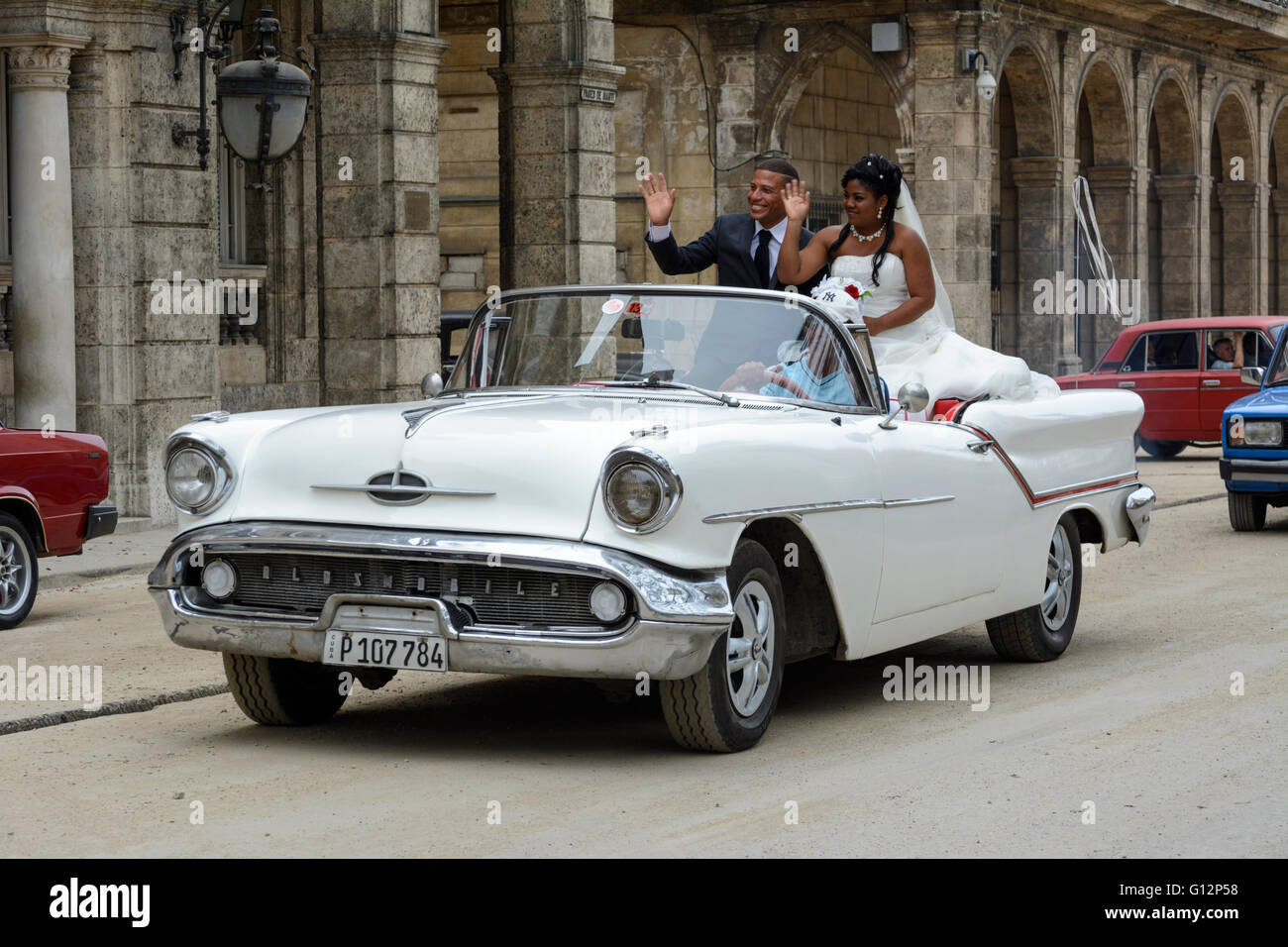 Newly weds celebrate their wedding with a tour of Havana in an open ...
