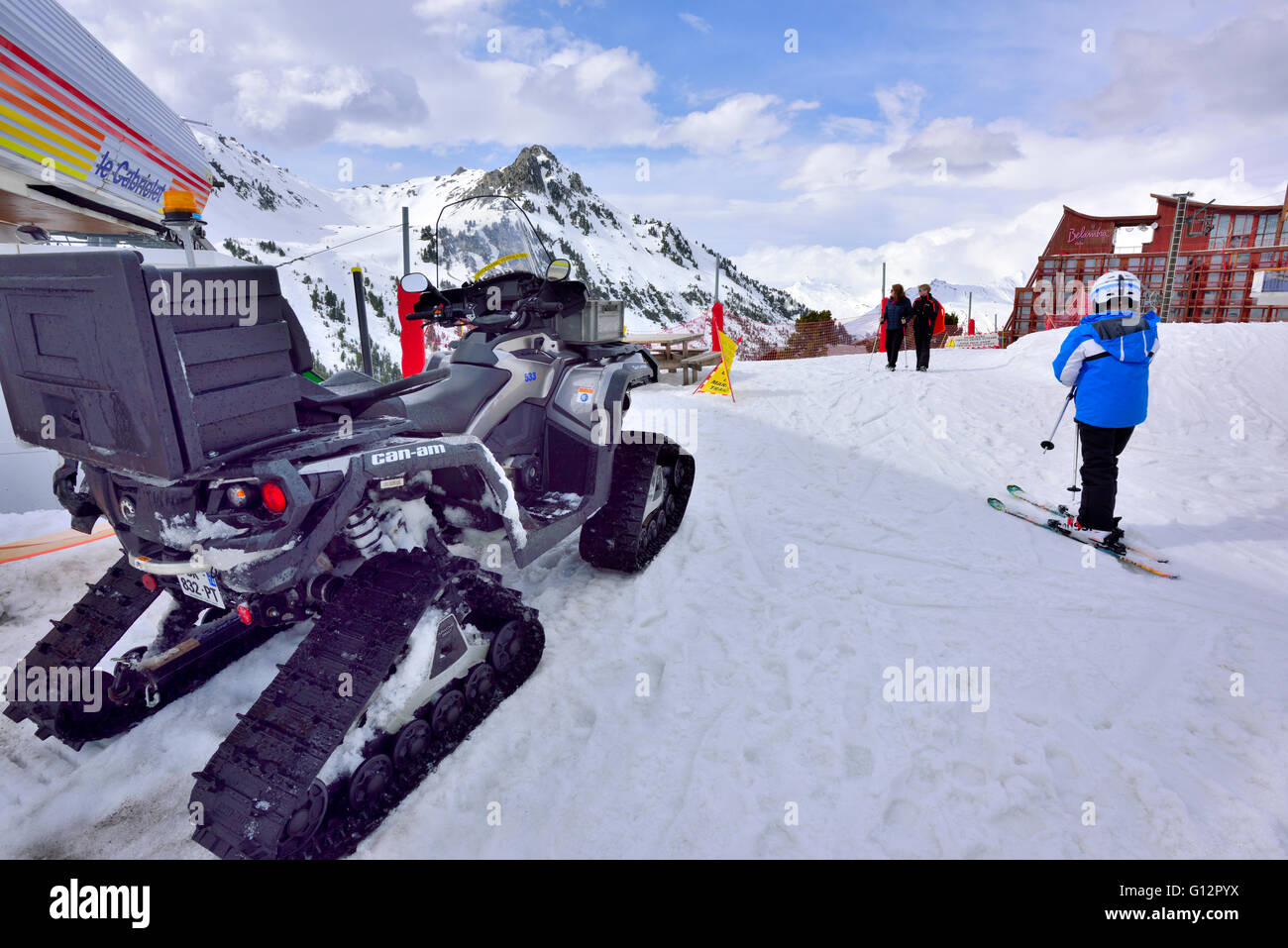 Arctic Cat Outlander Apache 360 tracked working snowmobile parked in Les Arcs in French Alps - Stock Image