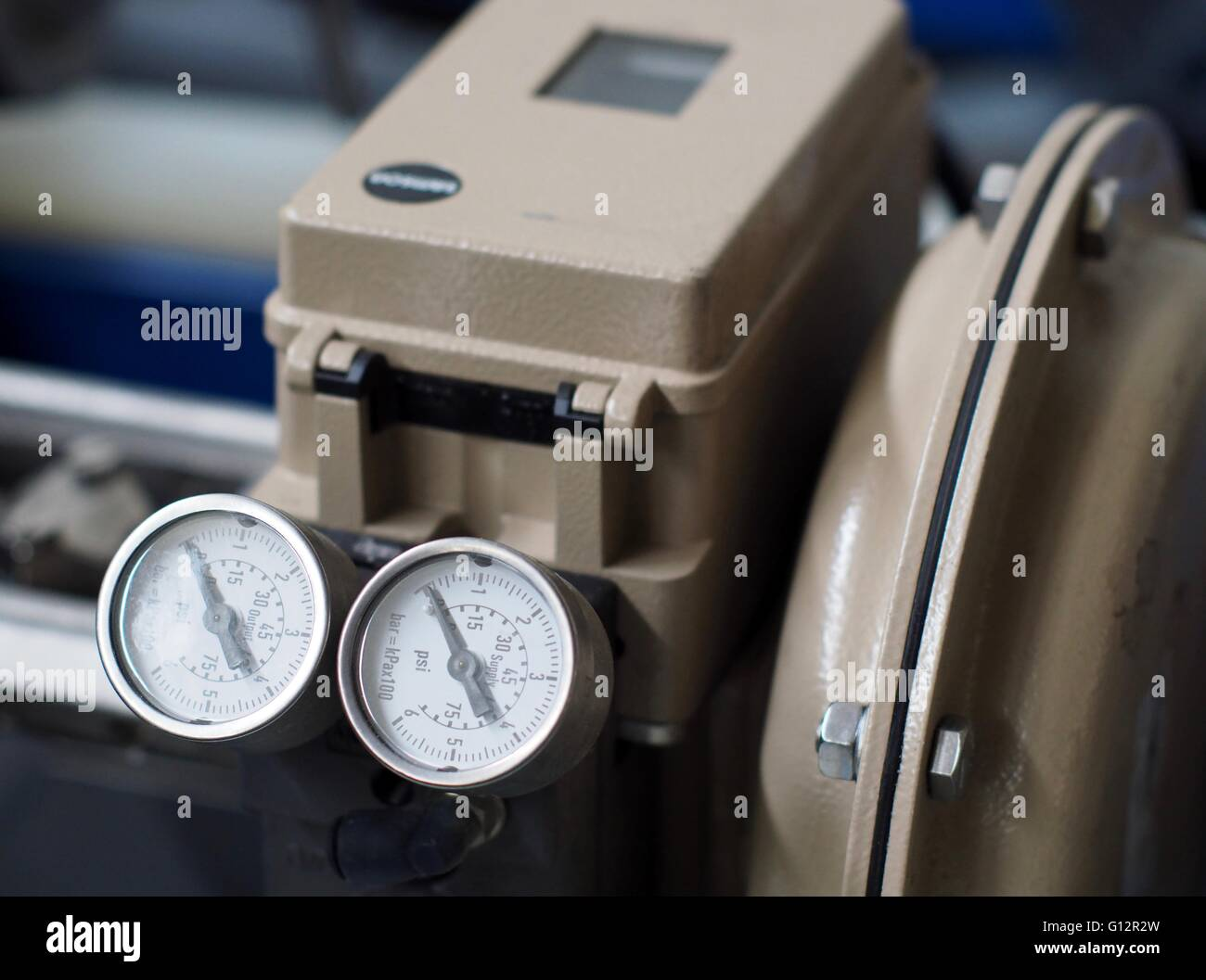 PSI dial gauges on industrial machinery Stock Photo