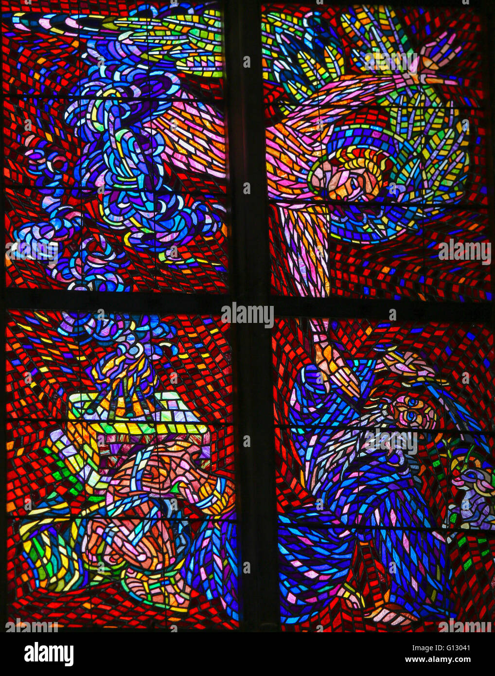 Stained Glass window in St. Vitus Cathedral, Prague, depicting Abraham and the Binding of Isaac on Moriah. - Stock Image