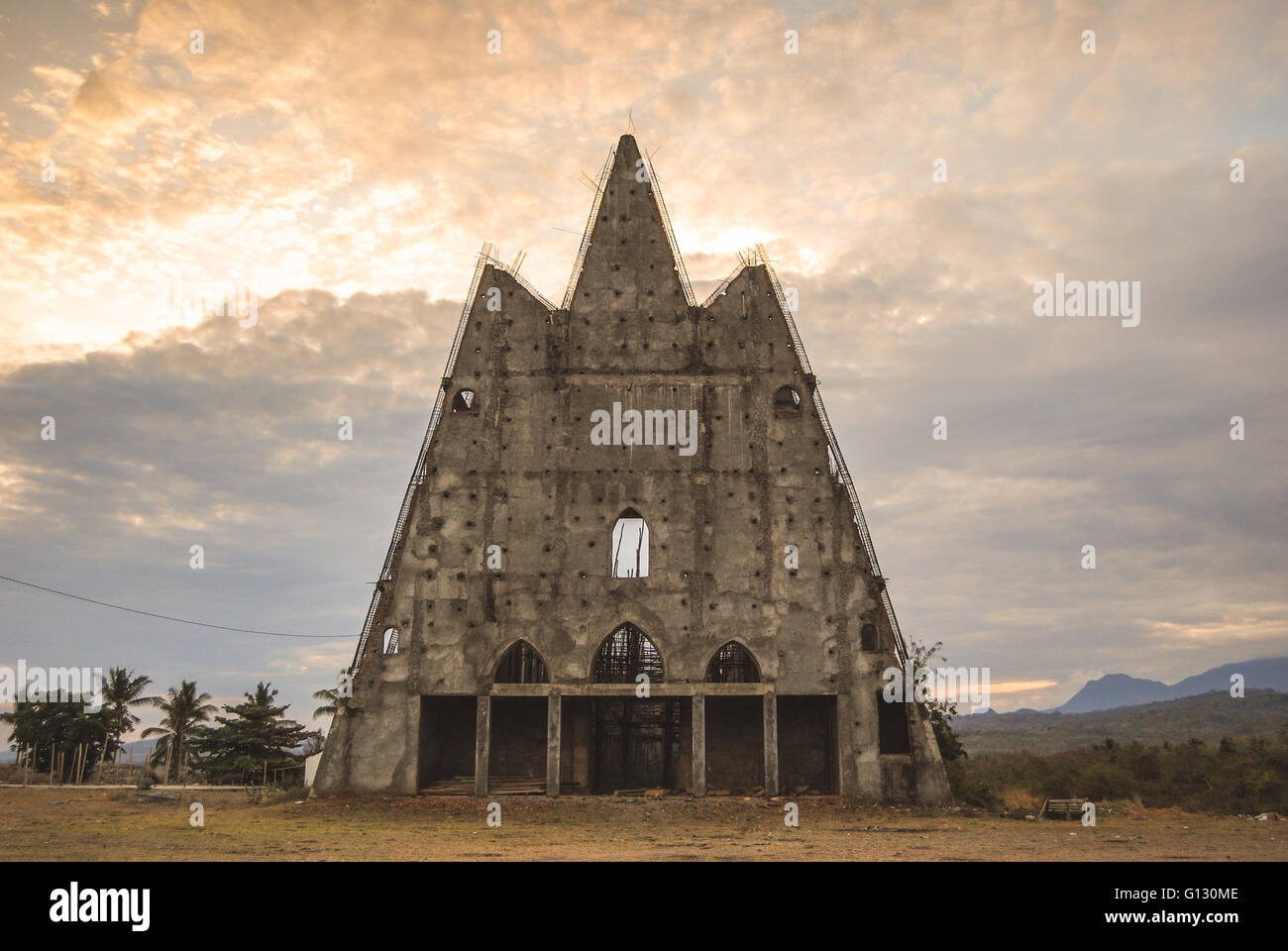 Unfinished and abandoned church in Suai, East Timor - Stock Image