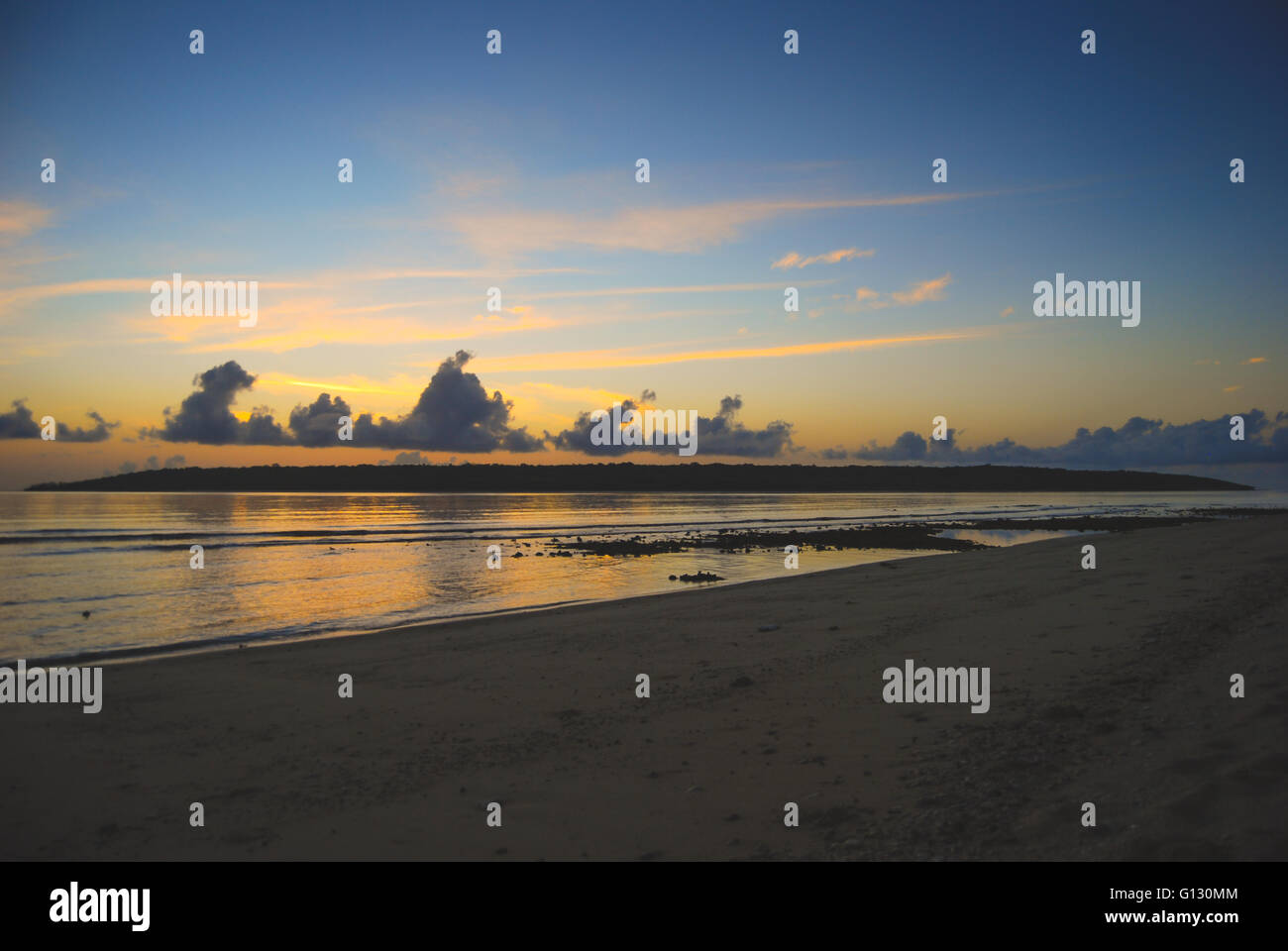 Sunset over Jaco Island in East Timor - Stock Image