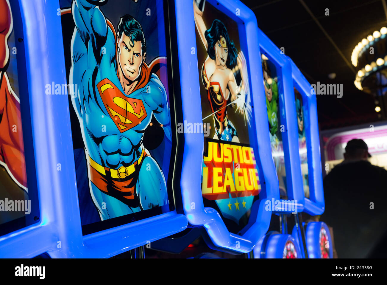 Justice League arcade game at an Amusement arcade on Morecambe seafront, UK - Stock Image