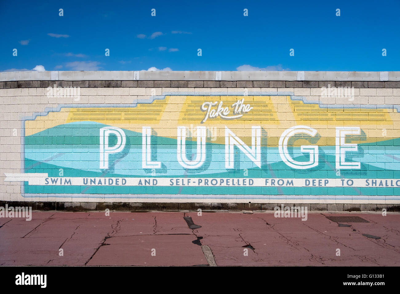 'Take the Plunge' sign on Morecambe seafront - Stock Image