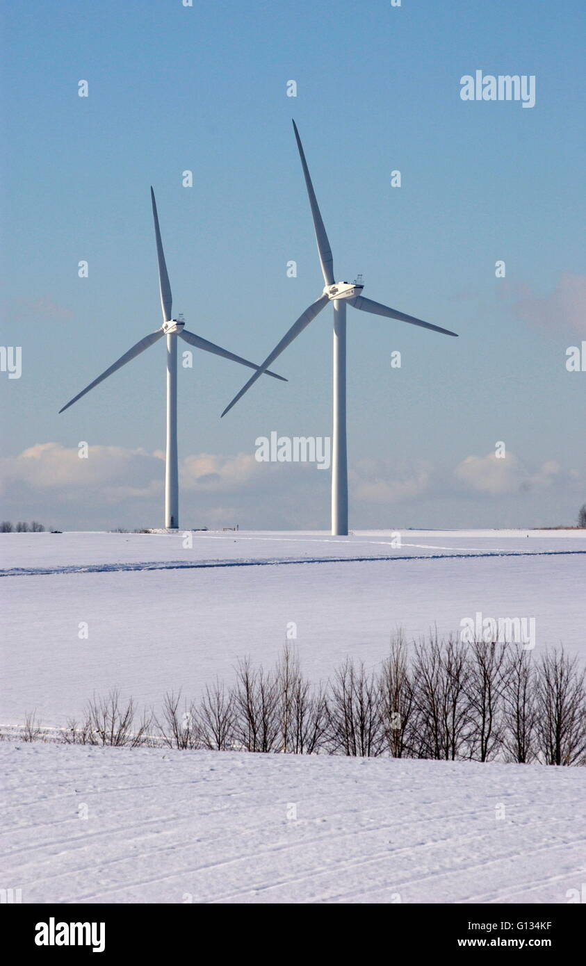 AJAXNETPHOTO - DECEMBER 2009. FRANCE. - WIND TURBINES GENERATE ELECTRICTY FOR LOCAL VILLAGES IN SNOW BOUND LANDSCAPE - Stock Image