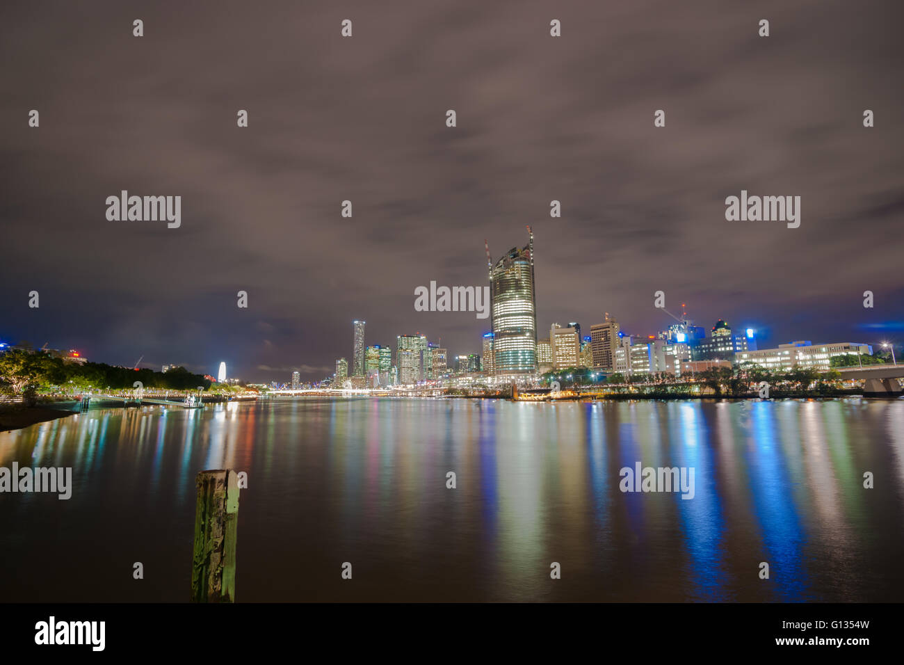 Briabane, Australia April 27 2016 lights and reflections Brisbane city skyline lights across river at night - Stock Image