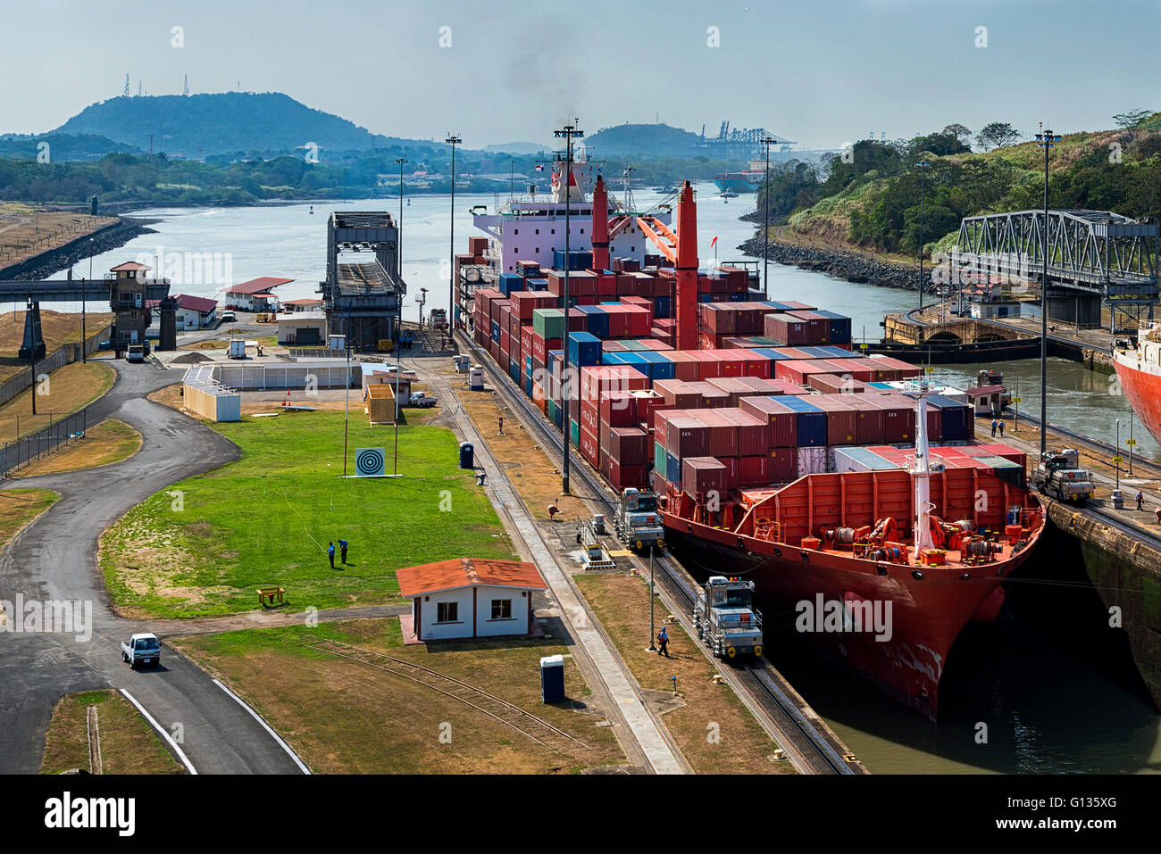 Panama Canal, Panama - March 3, 2014: A cargo ship entering the Miraflores Locks in the Panama Canal, in Panama - Stock Image