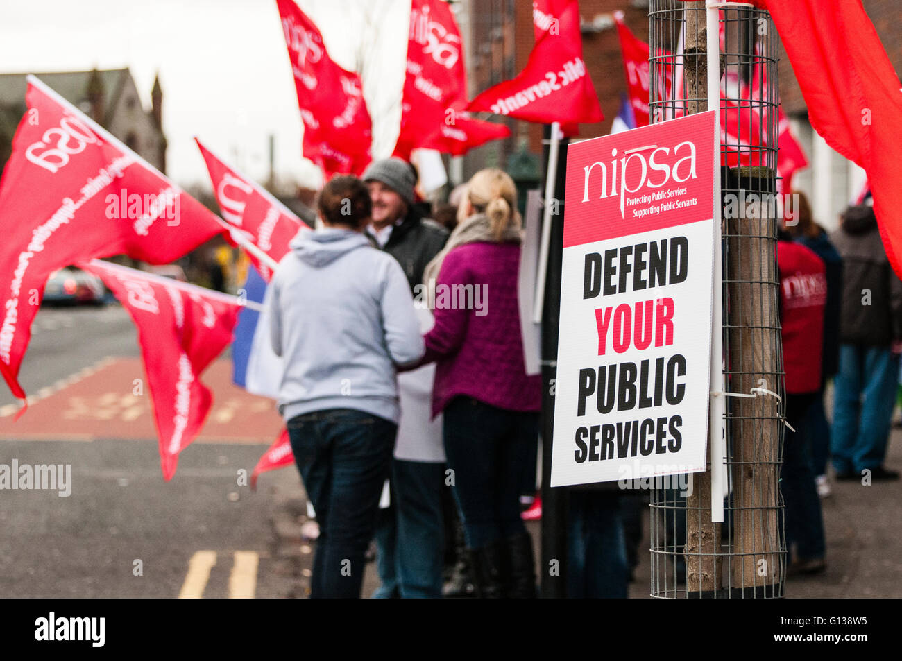 Belfast, Northern Ireland. 20 Nov 2011 - NIPSA placard saying 'Defend your Public Services' at a picket - Stock Image
