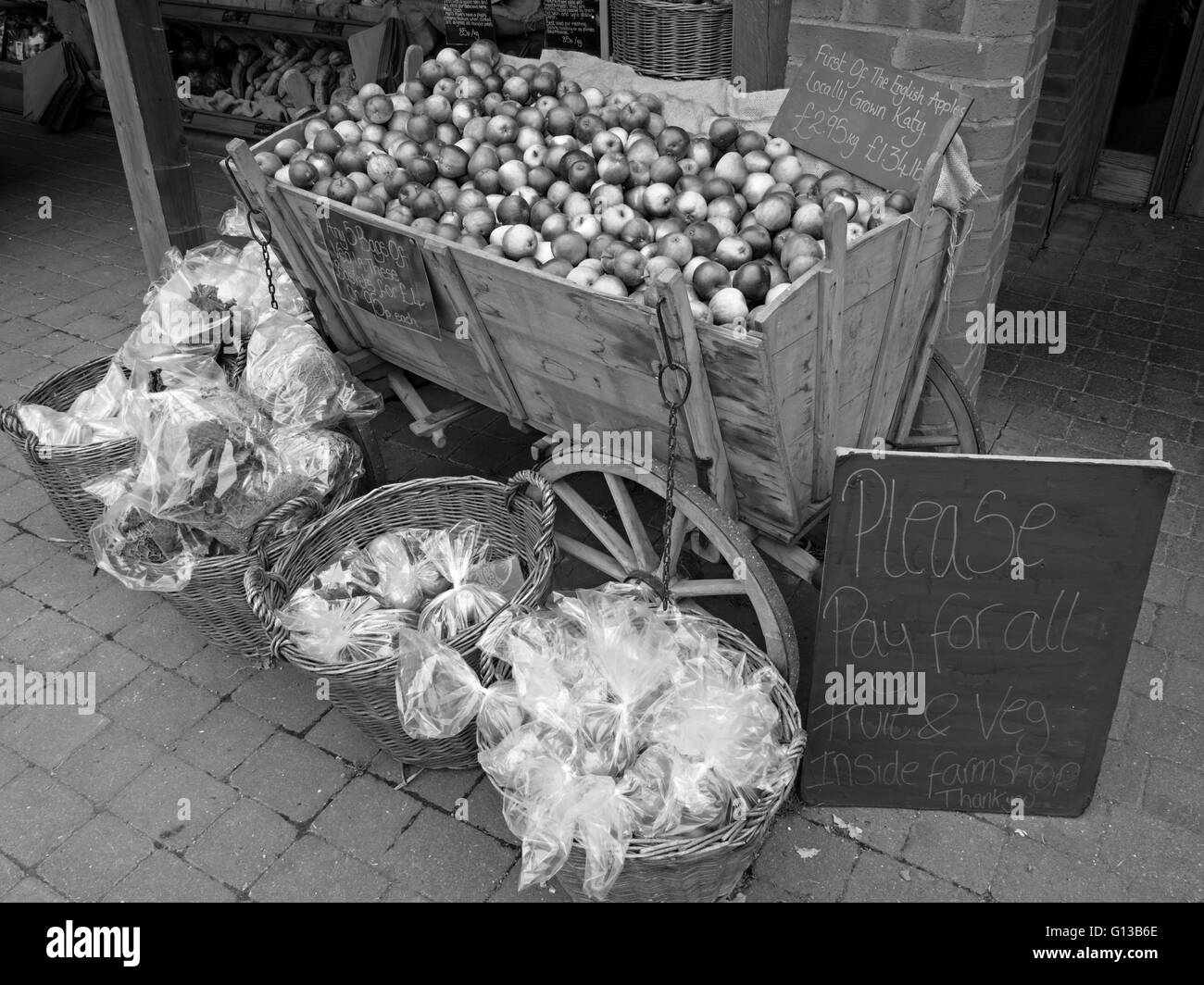 Locally grown English Apples for sale in old style wooden apple cart, Farm Shop, Doddington, Lincolnshire, England, - Stock Image