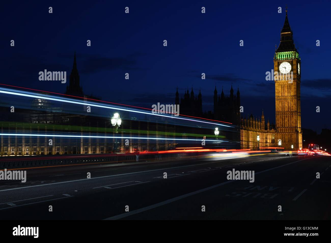 Night shot of Big Ben with light trails - Stock Image