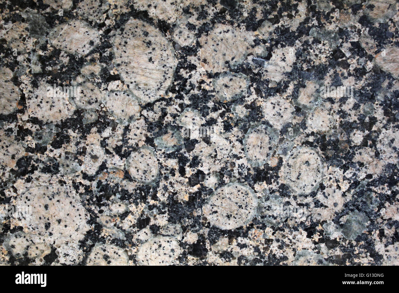 Natural weathered pink and black granite / marble texture - Stock Image