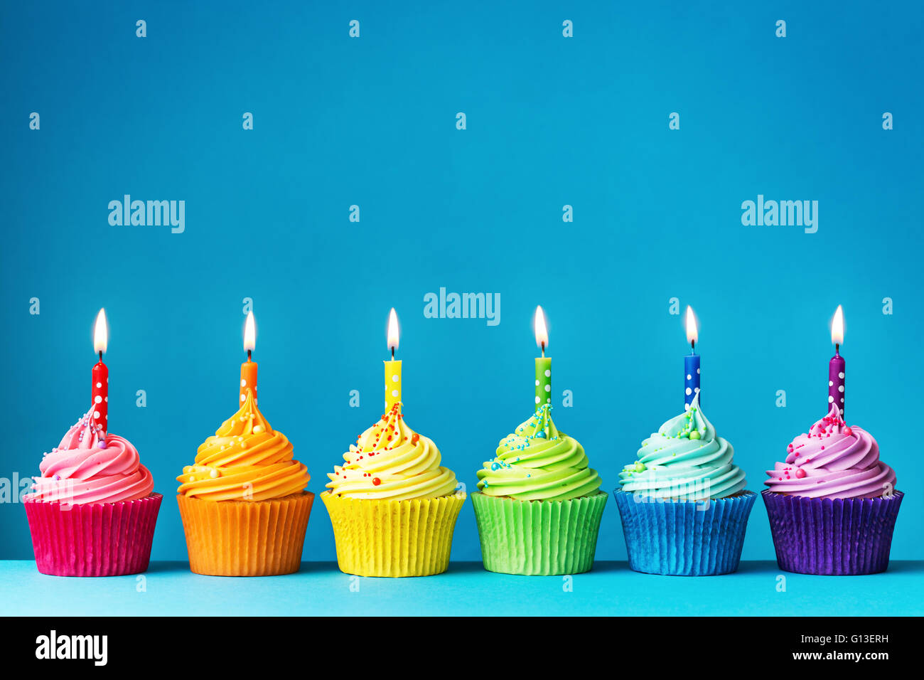Birthday cupcakes in rainbow colors - Stock Image