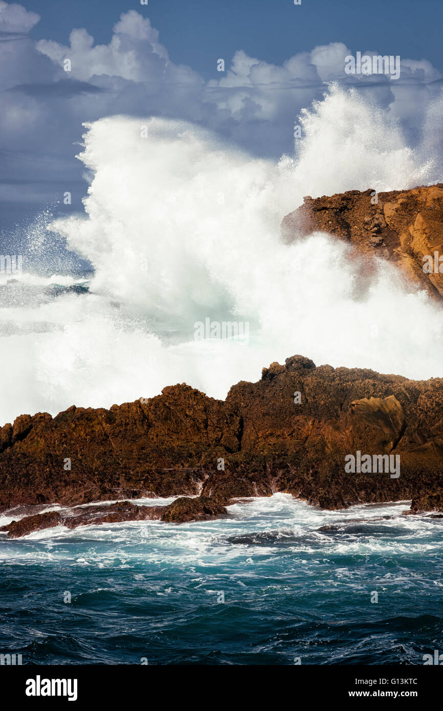 Massive waves explode against the cliffs at Point Lobos State Natural Reserve on California's Big Sur coastline. - Stock Image