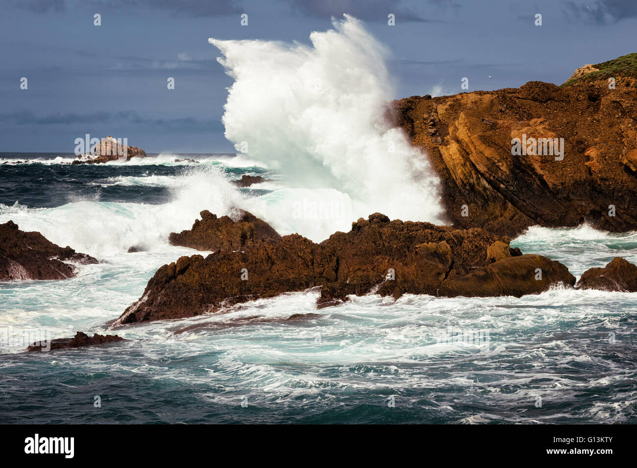 Large swells and heavy surf pound the cliffs at Point Lobos State Natural Reserve on California's Big Sur coastline. - Stock Image
