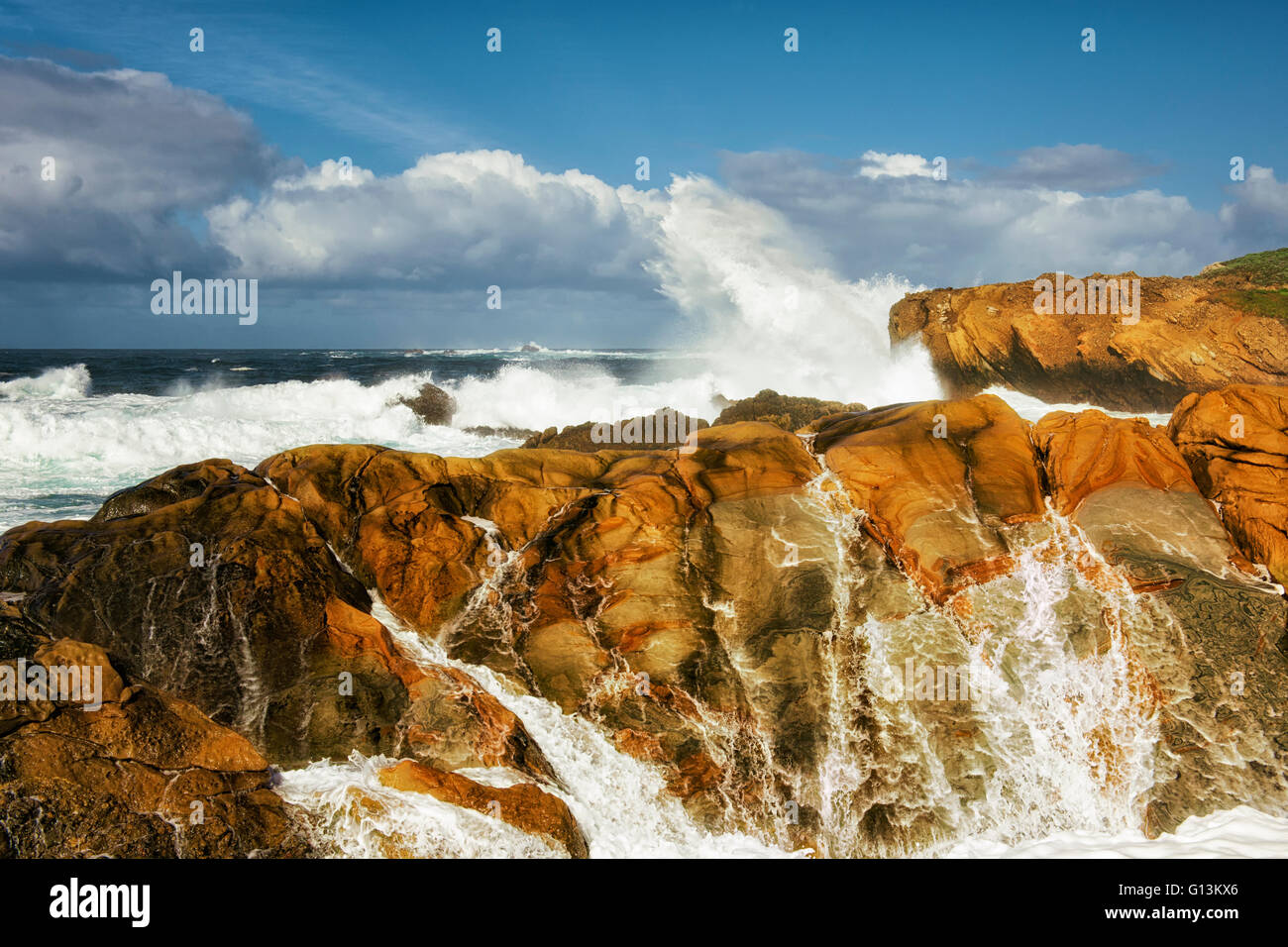 Crashing waves and high surf pound the sandstone cliffs of Point Lobos State Natural Reserve on California's Big - Stock Image