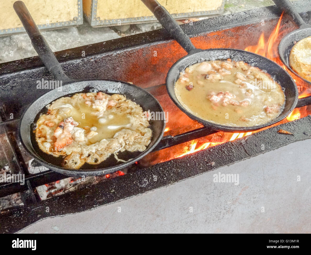 rustic stove with pans including a dish in Sweden - Stock Image