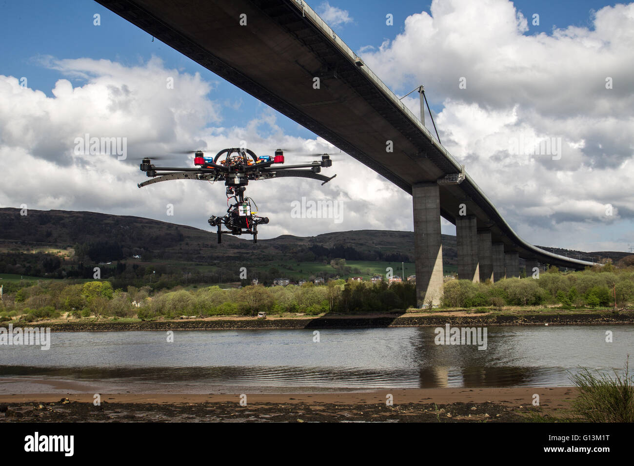 Drone flying next to Erskine Bridge Stock Photo