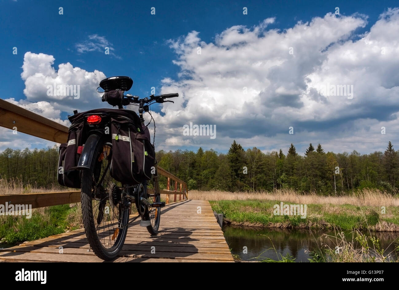 Tourism. Bicycle bridge over the river outside the city . Stock Photo