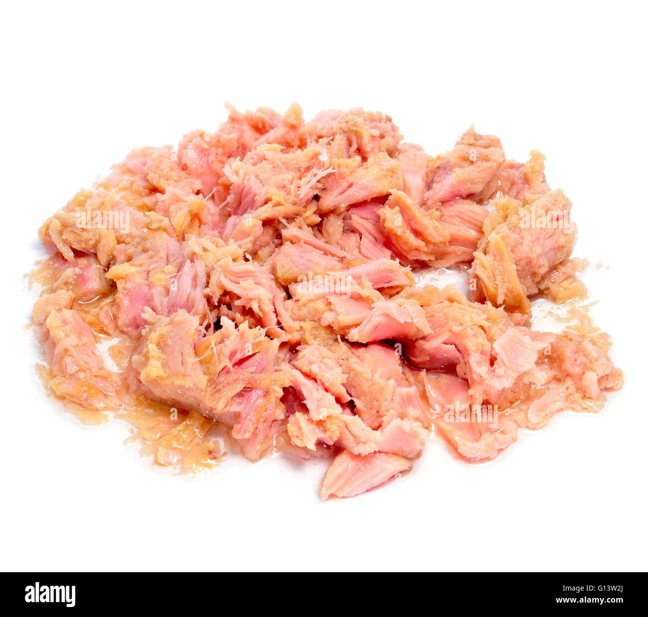 a pile of tuna meat from a can on a white background Stock Photo