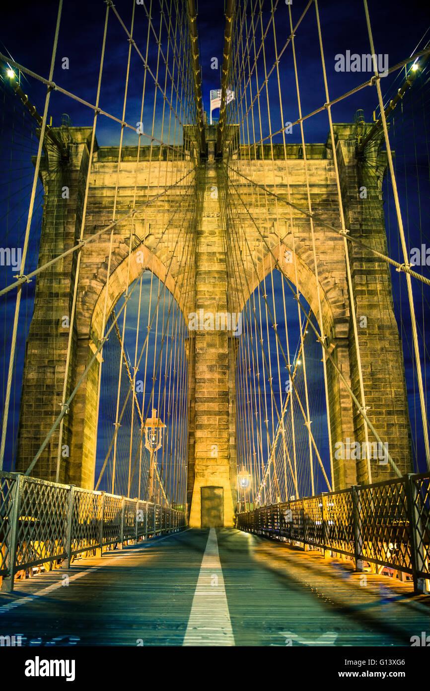 Night view of beautiful Brooklyn Bridge in New York City - Stock Image