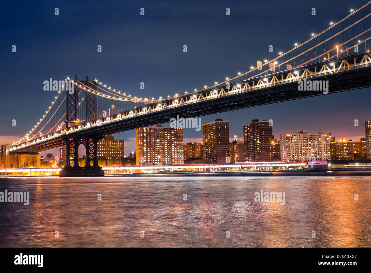 View of Manhattan Bridge from Brooklyn to Manhattan New York City seen lit up at night - Stock Image