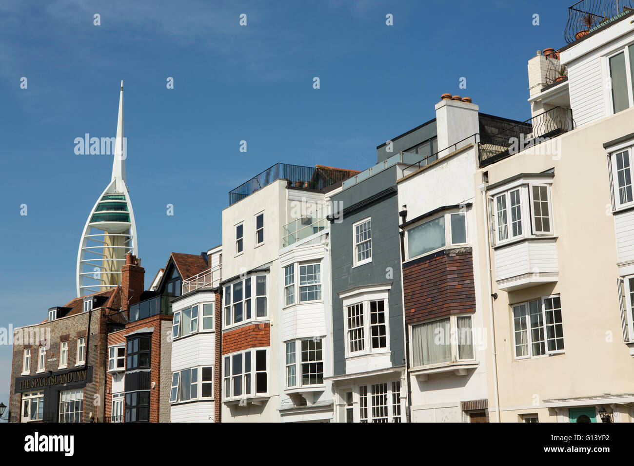 Row of heritage properties on Spice Island in Old Portsmouth. Portsmouth's landmark Emirates tower can be seen in Stock Photo