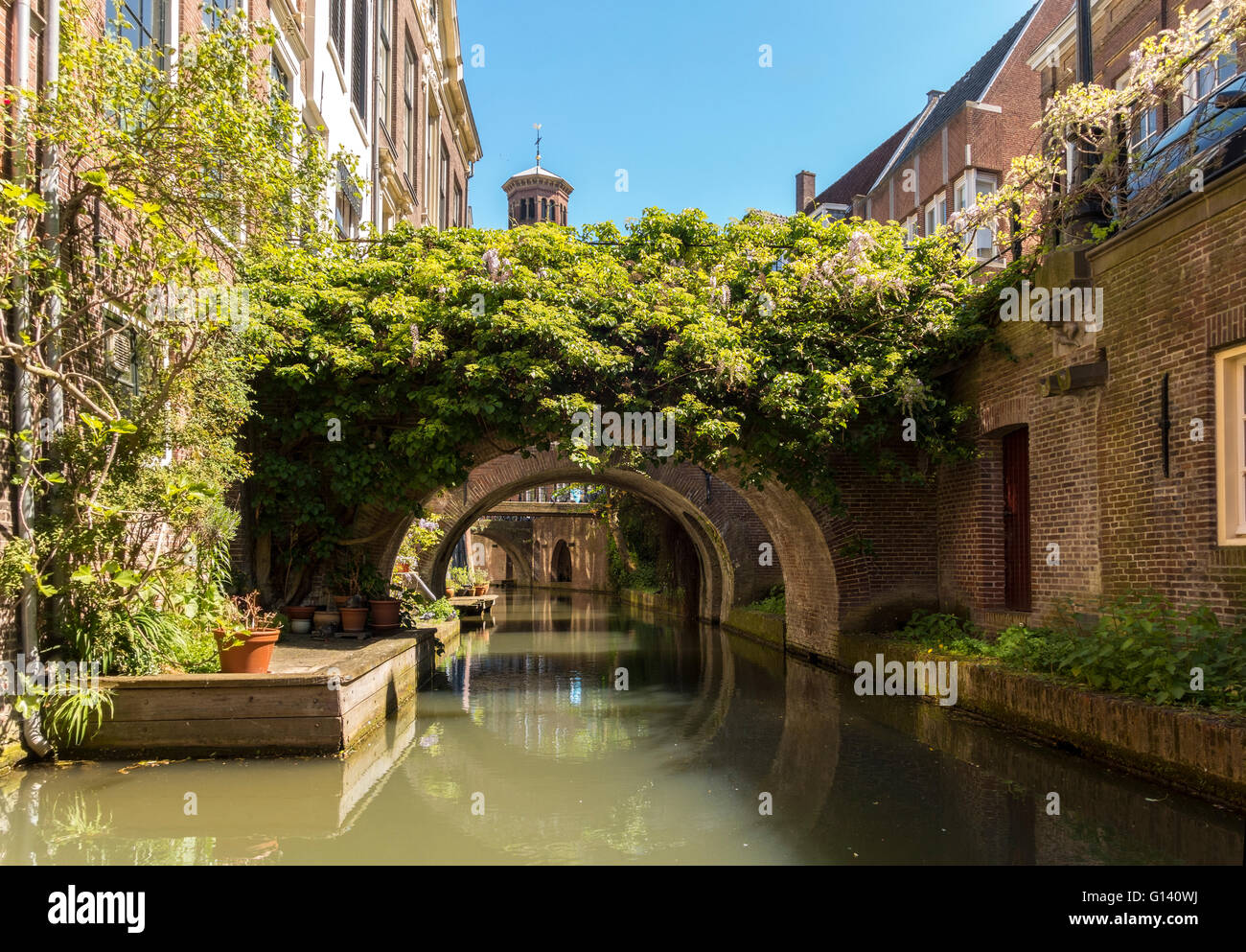Narrow canal in Utrecht The Netherlands. Kromme Nieuwegracht with private bridges. Stock Photo
