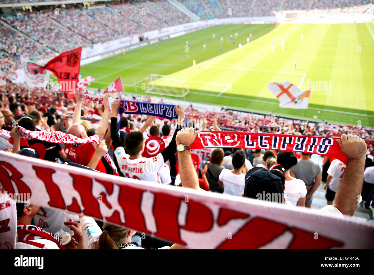 Leipzig, Germany. 08th May, 2016. Supporters cheer for their teams from the viewing stands at the German second division Bundesliga soccer match between RB Leipzig and Karlsruhe SC at the Red Bull Arena in Leipzig, Germany, 08 May 2016. Photo: JAN WOITAS/dpa (EMBARGO CONDITIONS - ATTENTION: Due to the accreditation guidelines, the DFL only permits the publication and utilisation of up to 15 pictures per match on the internet and in online media during the match.)/dpa/Alamy Live News Stock Photo