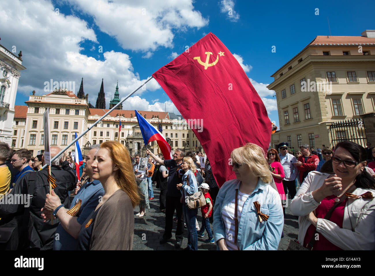 Prague, Czech Republic. 08th May, 2016. A woman holds a Soviet flag in front of the presidential palace during a Stock Photo