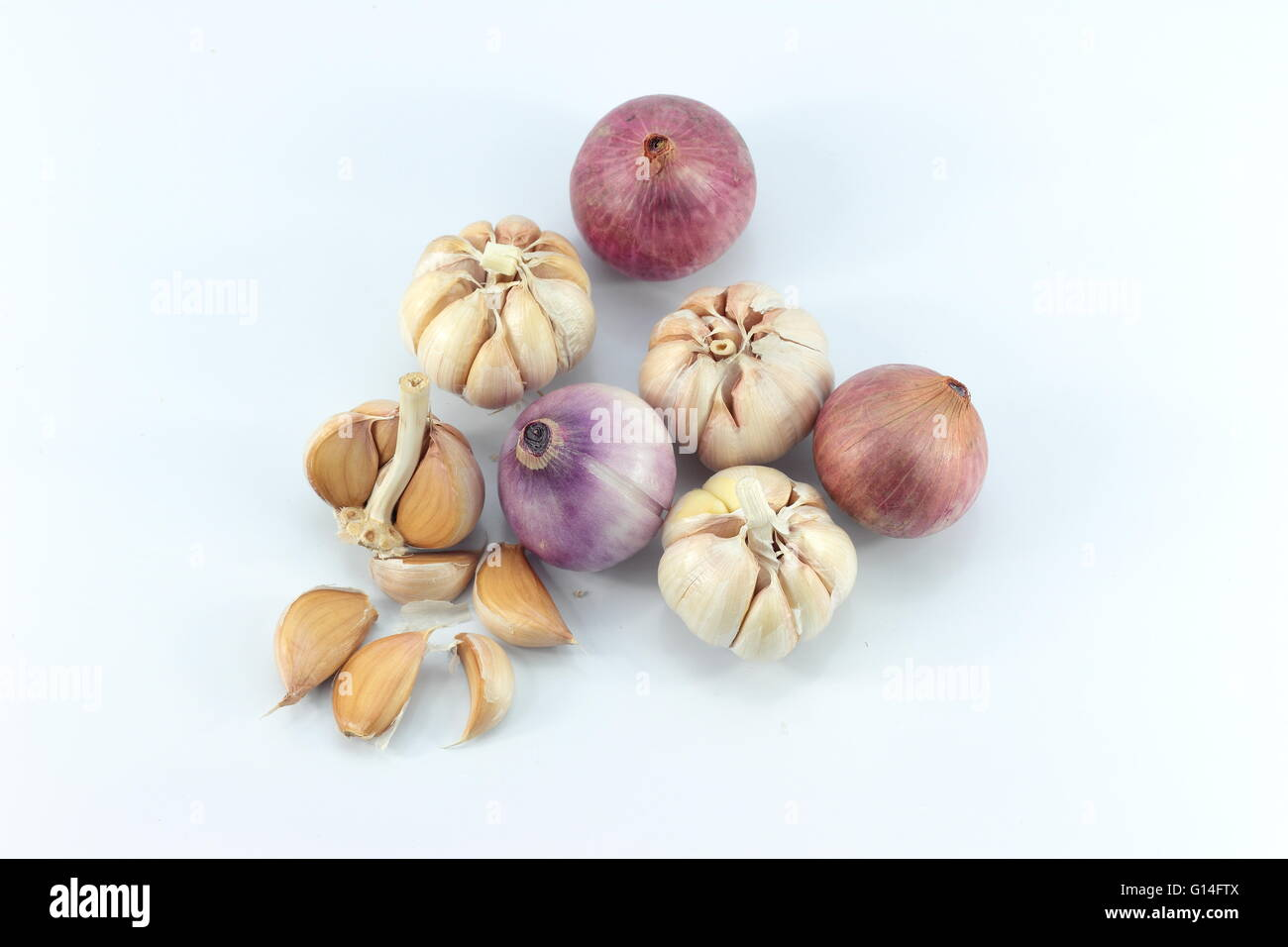 shallots and garlic  on white background - Stock Image