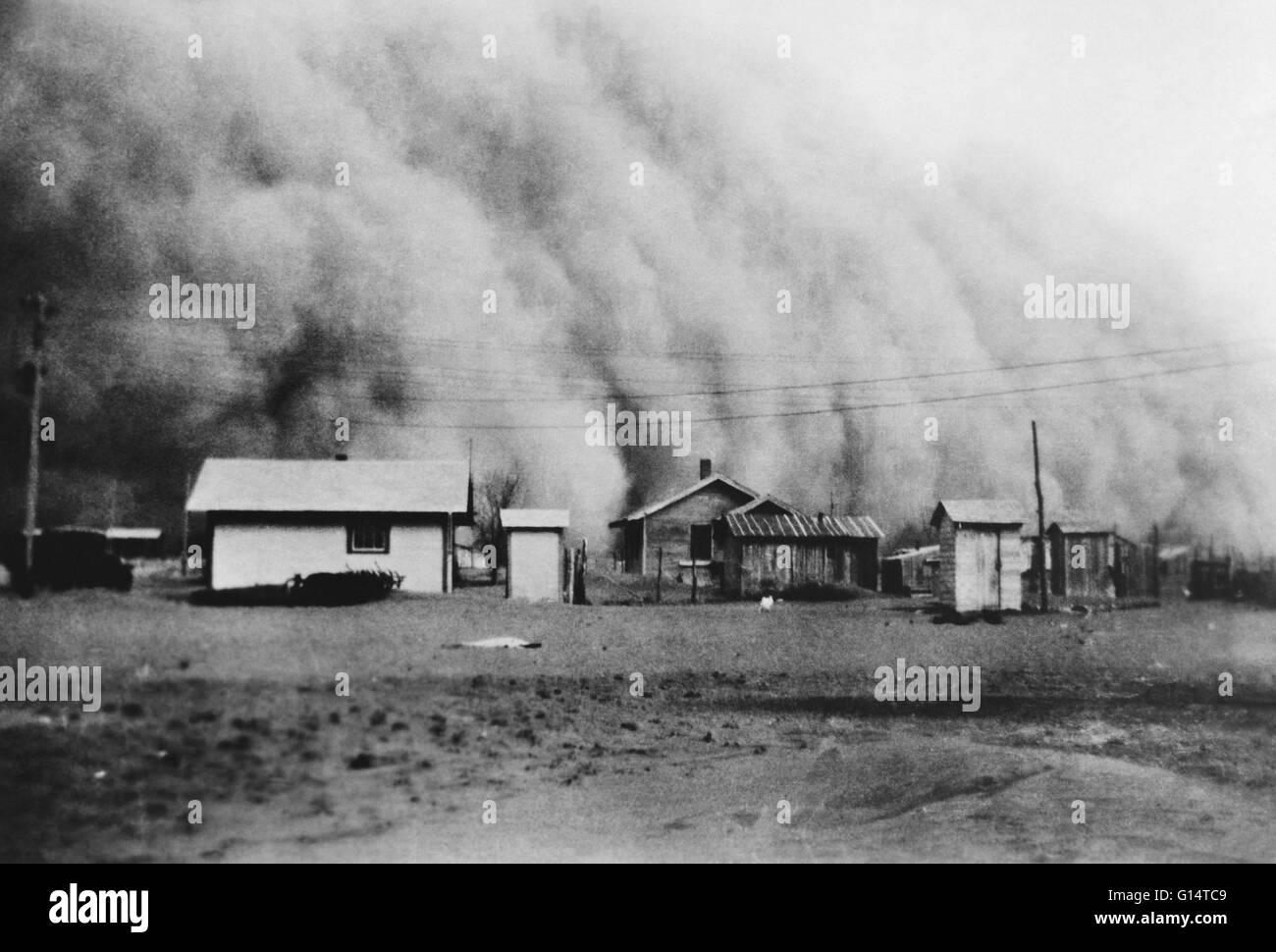 Huge dust storm hits Kansas during the Dust Bowl, an agricultural, ecological, and economic disaster in the Great - Stock Image