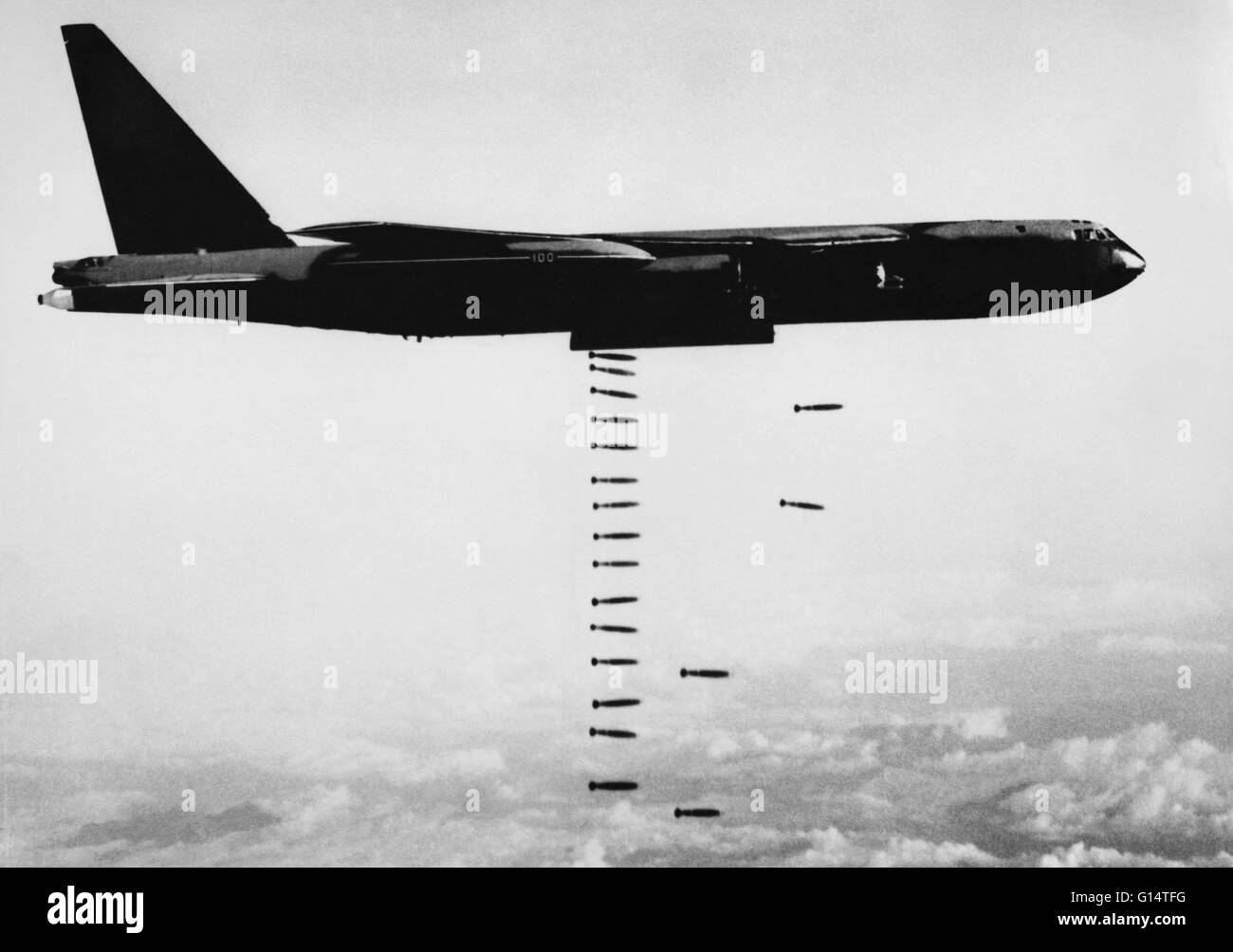 Undated image of a B-52 bomber dropping conventional bombs over Vietnam. The Vietnam War was a Cold War-era proxy - Stock Image