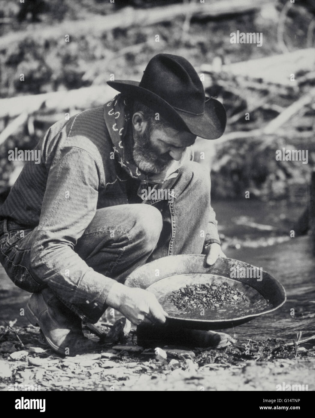 A prospector pans for gold in the Black Hills of South Dakota. The Black Hills Gold Rush began in 1874. The first - Stock Image