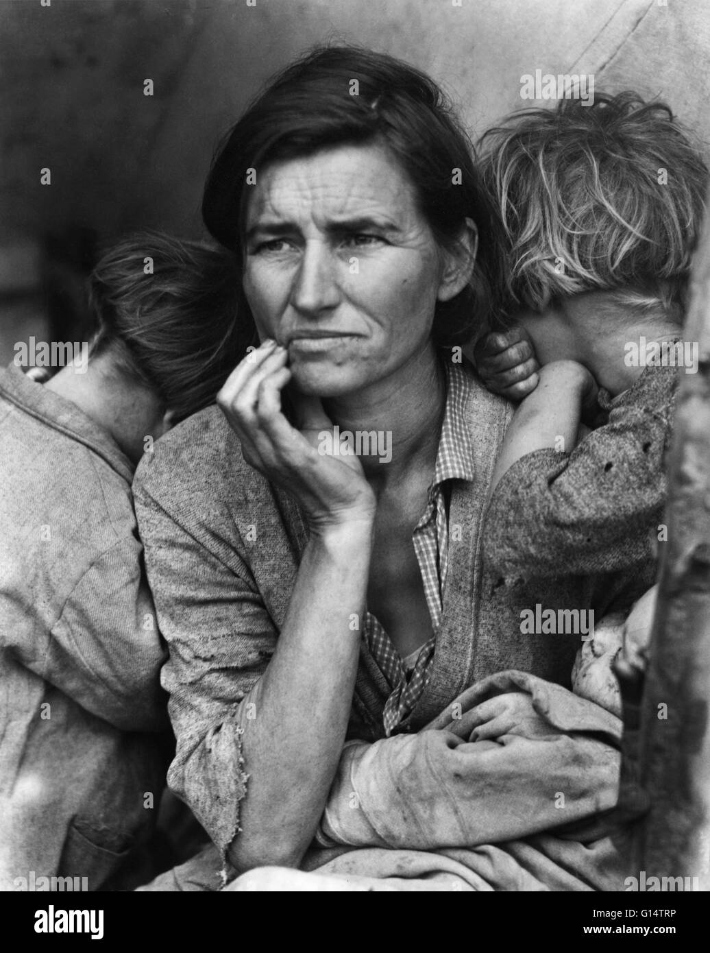 Dorothea Lange's famous photograph of a destitute mother with her children was taken in depression-era California. - Stock Image