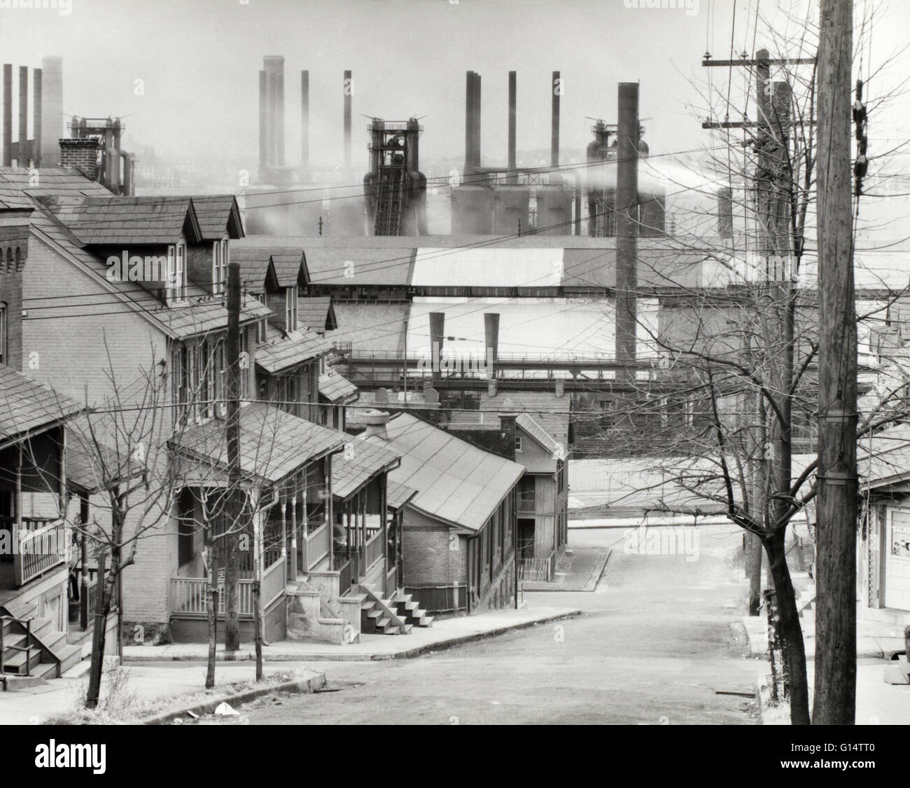 Houses and smokestacks of a steelmill in Bethlehem, Pennsylvania. Taken for the Farm Security Administration by - Stock Image