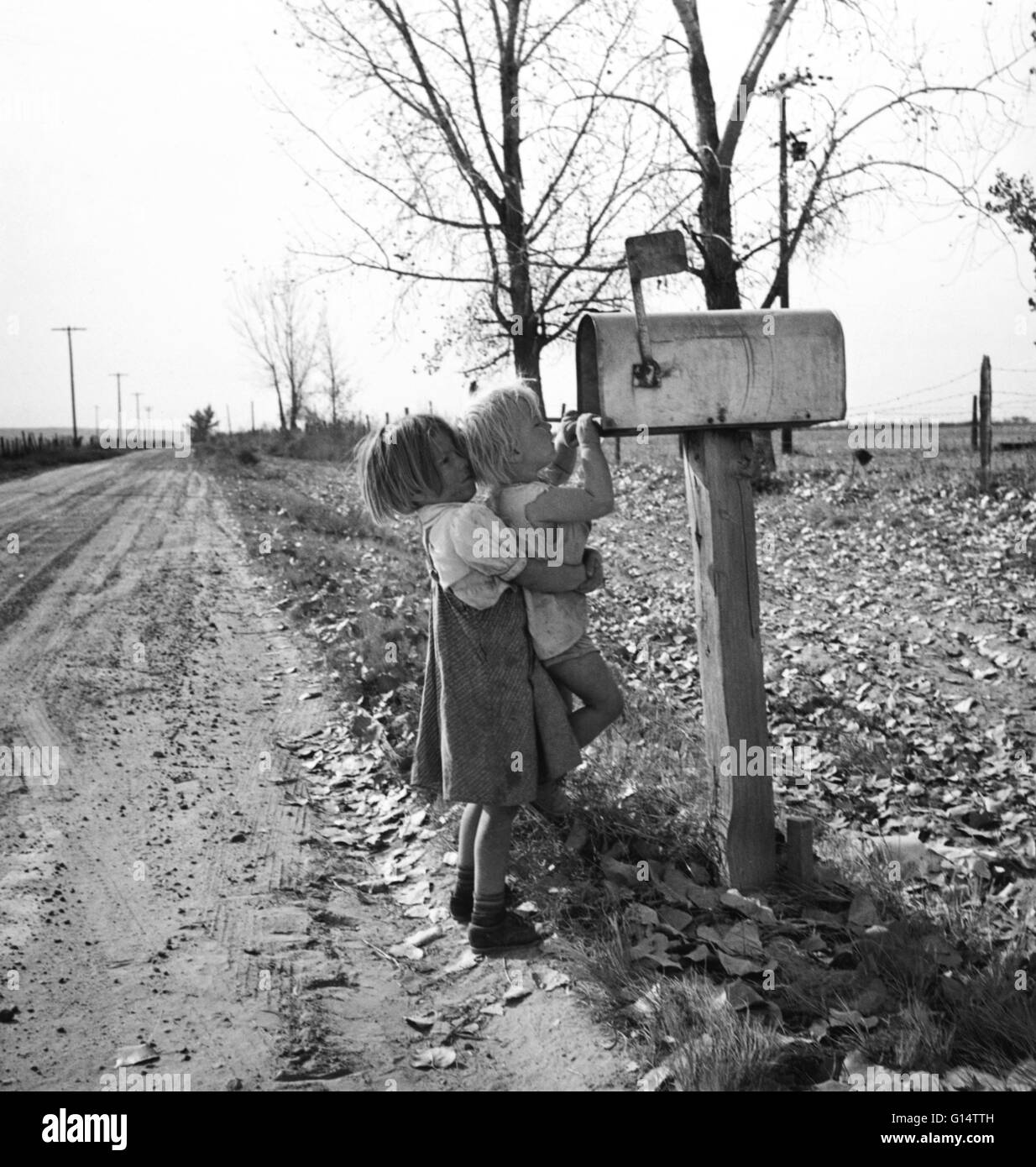 Two sisters check the mail in rural America during the Depression Era. - Stock Image