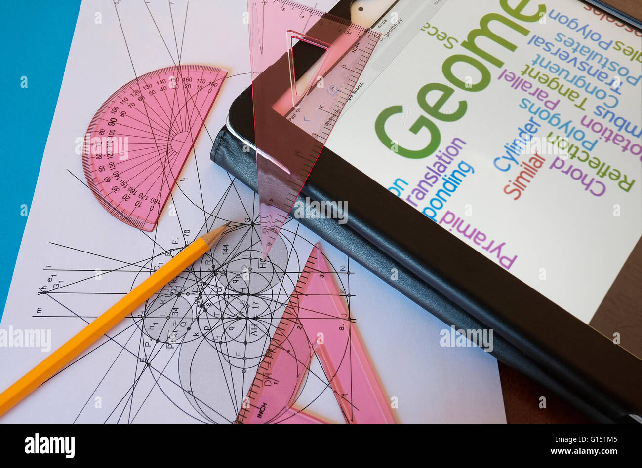 geometry set and tablet computer screen - Stock Image