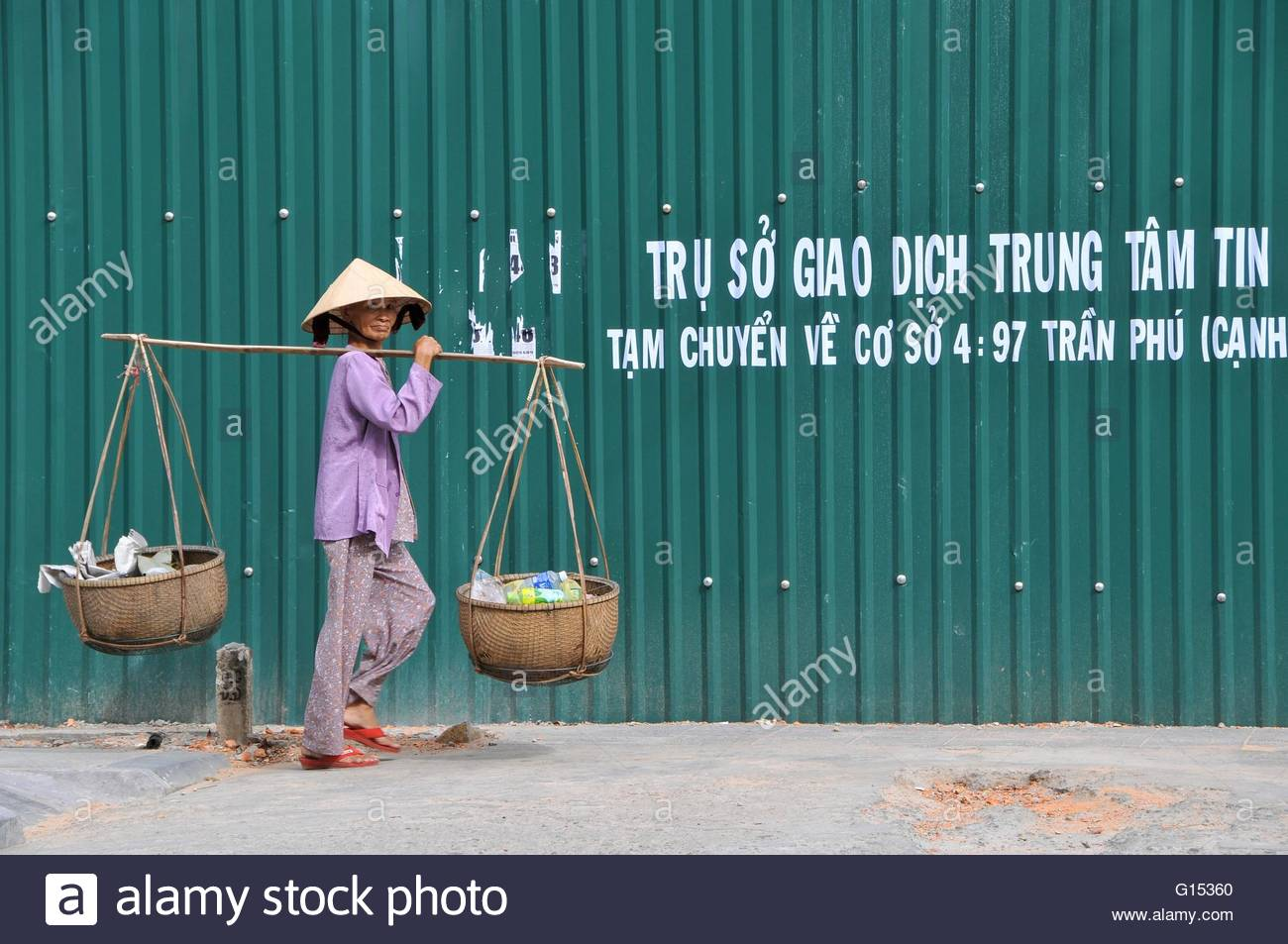 Vietnam, woman with yoke - Stock Image