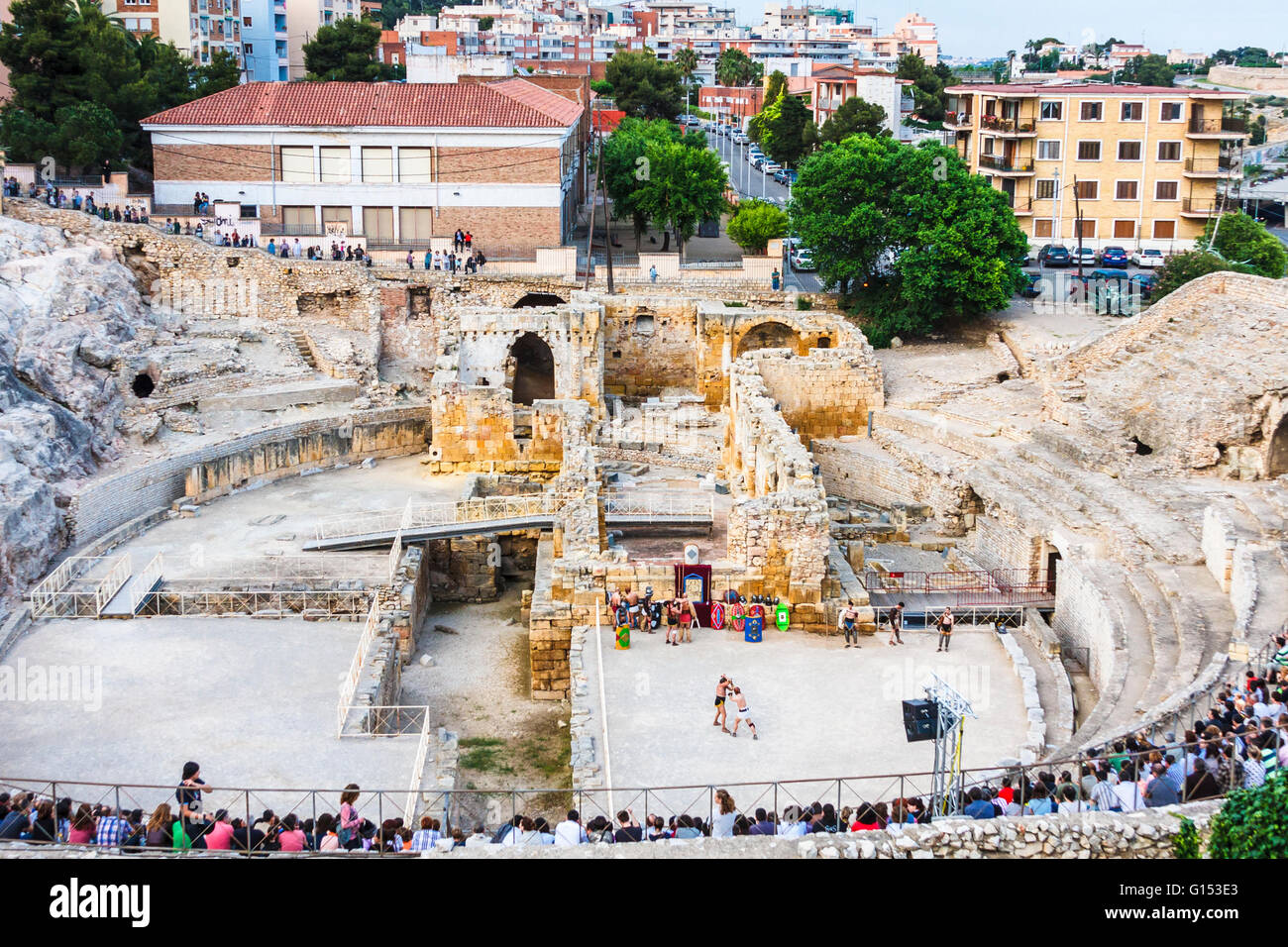 Audience inside the Roman amphitheatre in Tarragona, Spain, to watch gladitorial reconstructions during 'Tarraco - Stock Image