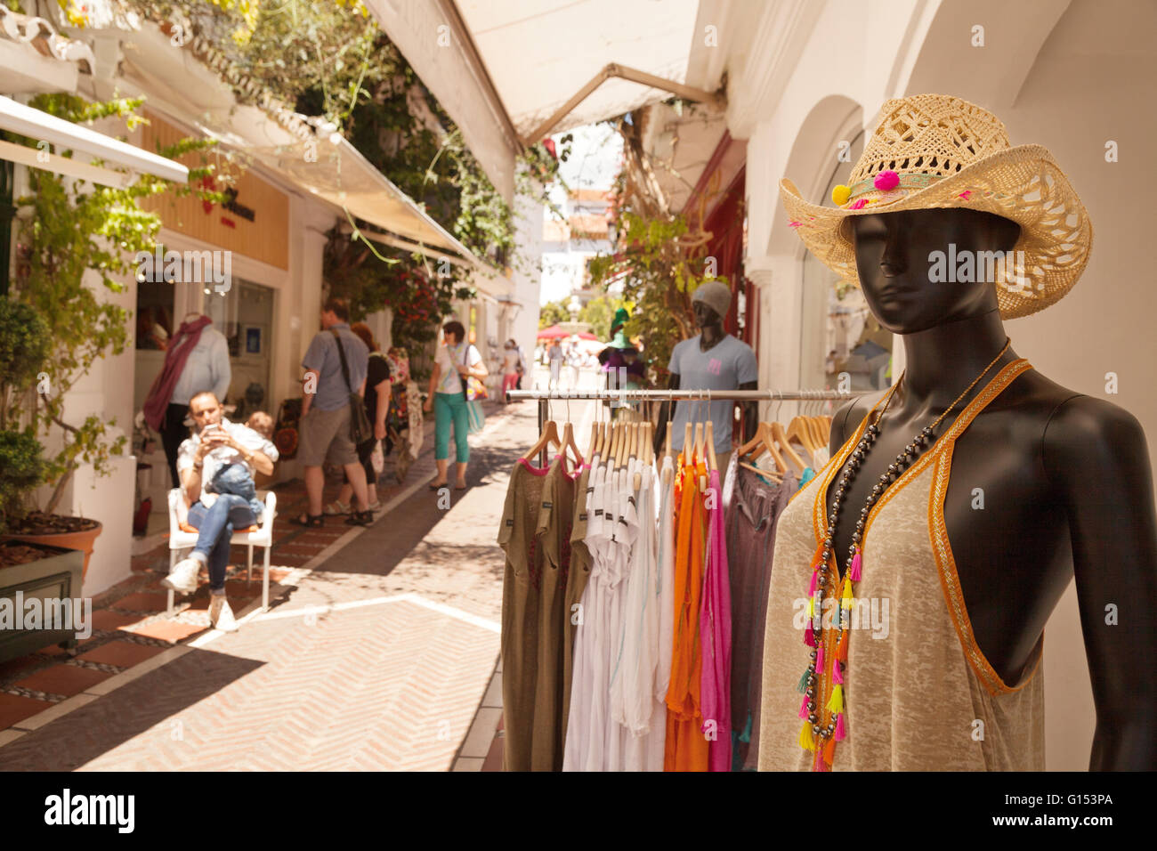 People shopping in the old town, Marbella, Costa del Sol, Andalusia Spain Europe - Stock Image