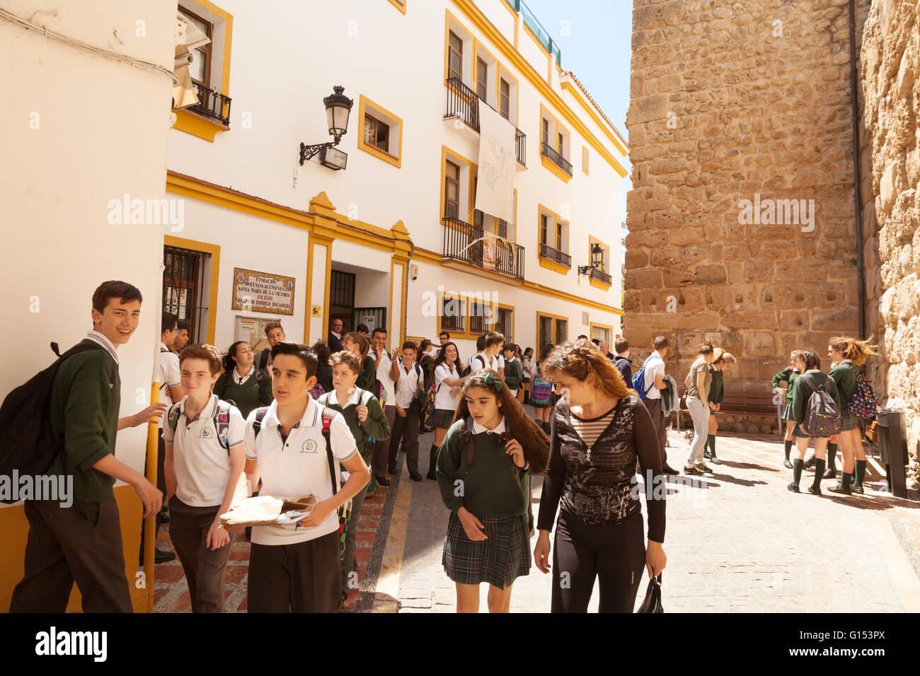 Spanish school children leaving school, Marbella, Andalusia Spain Europe - Stock Image